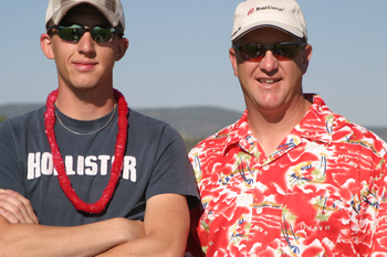 Todd Morris of Xcel Energy, right, organized Saturday's tournament, which had a luau theme, with the help of Tim Nelson and Brenda Boes. His nephew, Roston, played on one of the 11 teams.