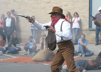 Phil Jannes played one of the bank robbers in last year's re-enactment at the corner of Sixth and Main in downtown Meeker. This year's bank robbery re-enactment will be held at 1:30 p.m. Saturday in the same location.