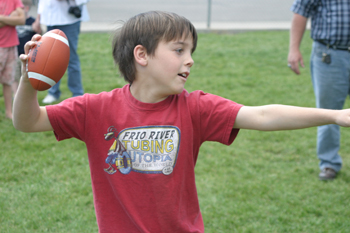 Chase May of Meeker takes aim at throwing a football through a tire during last year's Fall Festival in Meeker.