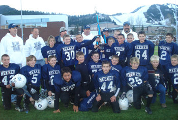 Members of the fifth- and sixth-grade Meeker Mustangs football team celebrated after their Super Bowl win Sunday. The younger Mustangs team finished second.