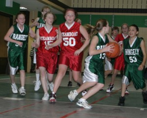 Rangely seventh-grader Carrie Goddard looked to pass the ball while teammate Alycia Dominguez looked on.