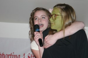 """McKenna Kummer sang a song from the Broadway musical """"Wicked,"""" with assistance from Reagan Pearce, during the talent show at last week's Meeker Chamber of Commerce annual banquet."""