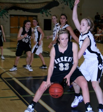 Meeker's Stacey Fitzgibbons wheels around a Front Range Christian defender for two of her game-high 26 points.