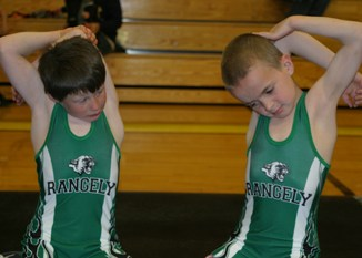 Rangely peewee wrestlers Tytus Coombs, left, and Calvin Bishop stretched before Saturday's Meeker tournament. Coombs was a first-place finisher, while Bishop placed third.