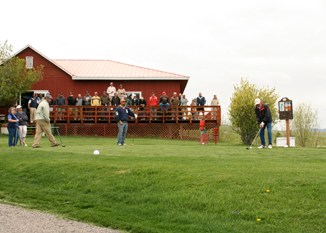 A crowd watched as a golfer teed off in Saturday's Bob Tucker Memorial Golf Tournament at the Meeker Golf Course.