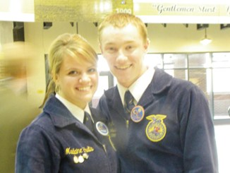 Meeker's Maclaine Shults, pictured with the FFA president from Alaska, won a bronze in the creed competition at nationals.