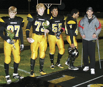 Senior football players, including from left Jared Frantz, Ryan Wix, Victor Villalpando, Alema Atoafa and Trevor Matrisciano, honored their parents before last Friday's homecoming game.