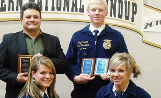 Maclaine Shults (bottom left), Stacey Fitzgibbons (bottom right), coach Clint Shults (top left) and Clay Carlson (top right) of New Raymer won a national title in livestock judging at the National Western Stock Show held last week in Denver. The team beat 12 other teams from across the country to qualify for the Highland National Contest in Scotland this coming June. The team won four divisions, placed second in another and earned a fifth place finish in another.