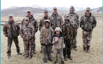 Courtesy Photo Participating in the Youth Turkey Hunt were (back) CDOW officer Terry Wygant, Jeff McGuire, CDOW officer Jon Wangnild, CDOW officer Mike Swaro, Brad Bauer and Joe Newman. (Front) Caitlyn Shepherd, Brennan Jensen, Kyle Wangnild, Eli Newman.