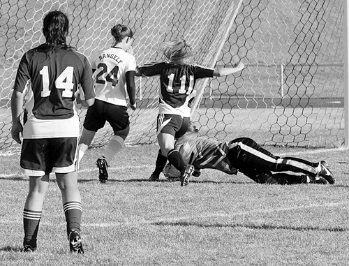 Panther senior Haeley Enterline saves a goal by covering the ball. Enterline has 124 saves this year.