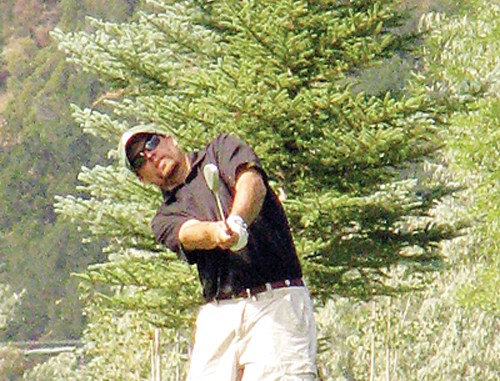 """J.C. Watt, pictured chipping onto the green on No. 8, defended his men's club championship with a one-shot victory last Saturday at the Meeker golf course. The humble champion did not know how many times he has been the club champion but smiled when asked if """"multiple times,"""" would be correct."""