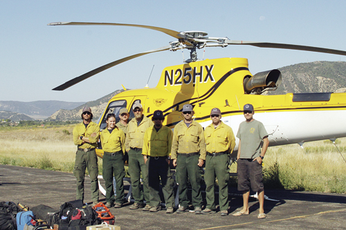The Teton Helitack crew from the Bridger Teton National Forest out of Jackson, Wyo., spent 14 days camped at the Meeker Airport and responded to 15 fires during their stay. The crew included helicopter crew members Nic Glatt and Kate Ball, helicopter mechanic fuel truck driver Randy ??, crew members Chris Edwards and Philip Brass, squad leader Matt Lancaster, crew supervisor David A. Gomez and helicopter pilot Steve Wilson, with Helicopter Express.
