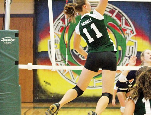 Rangely senior Quincey Thacker goes up for one of her 55 kill attempts, of which she got 17 in a homecoming win against Soroco.