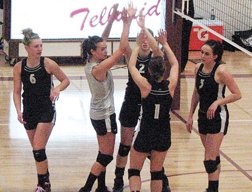 Meeker volleyball players Taylor Neilson, Piper Haney Aly Ridings (2), Kaysyn Chintala (1) and Jordan Brown celebrate after scoring in the regional tournament held last Saturday in Telluride. Although the lady Cowboys did not advance to the state tournament, the team had plenty to celebrate, finishing the league as the No. 4 seed, beating the league champions in the district tournament and finishing second in the region.