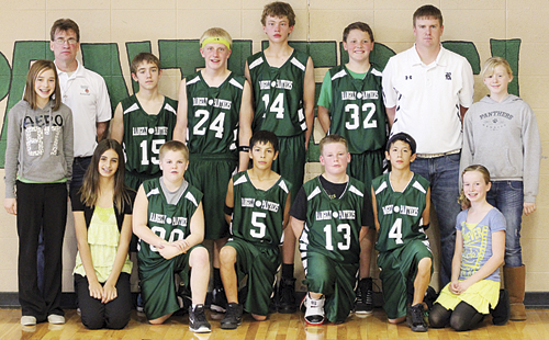 The Rangely Middle School boys' seventh-grade basketball team entered the annual league tournament as the No. 1 seed and finished as league champions. Pictured with the championship trophy are Alexis Lamoreaux, Stetson Cudo, Devin Ramirez, Gavin Lancaster, Kobe Broome and Cassidy Brown. (Back) Coach Mark Skelton, Trevor Austin, Patrick Scoggins, Brennan Noyes, Austin Ficken, coach Jeremy Lohery and Abby Shriver.