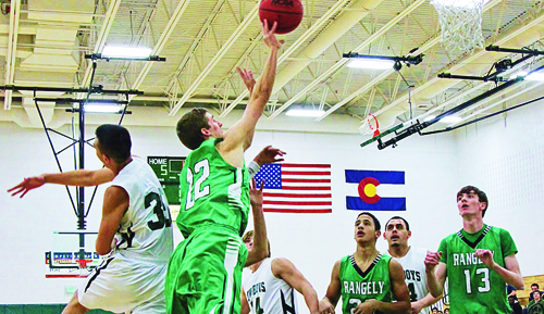 Rangely High School junior Andrew Morton (22) making a side shot. Andrew was high scorer against Plateau Valley. Junior Cameron Enterline (13) and sophomore Luis Contreras (20) assist.