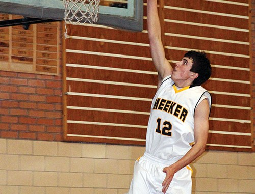 Jeremy Musgrave, who led the Cowboys with 19 points last Friday and 20 points last Saturday, scores on an easy layup after a turnover.