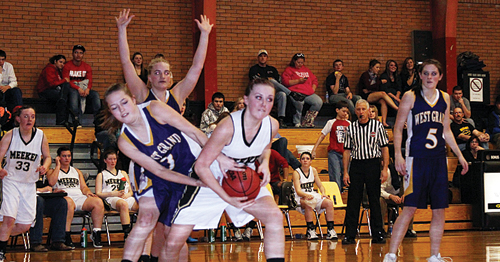 Meeker senior Kacey Collins fights for a rebound against West Grand.