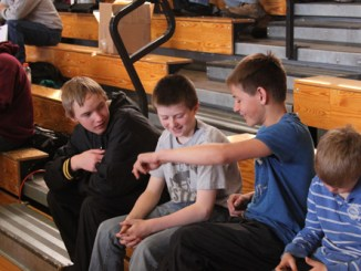 Clay Anderson, left, and Daylon Nielsen, right, talk with sixth-grader Tannen Kennedy before wrestling at the recent Barone Middle School tournament. Anderson was incorrectly identified using his brother's name in last week's issue of the Herald Times, which also listed him as a seventh-grader and that neither wrestler placed. Anderson is an eighth grader who placed fifth in the tournament and Nielsen finished in fourth place.