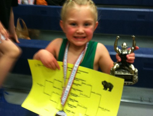 Carmella Fortunato, age 4, brought home some extra hardware from her first-ever wrestling tournament in Rifle. Not only did Fortunato win a gold medal for going undefeated in her bracket, attending coaches also gave her the sportsmanship award for her age division.