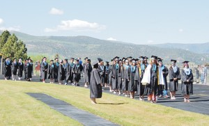 Seniors in the Meeker High School Class of 2013 lined up on the track at Starbuck Stadium moments before starting the procession to their seats for commencement. Clear skies and sun mixed with the green hills in the background to make for a great day for the 47 members of the class as they passed one of the major milestones in one's life.