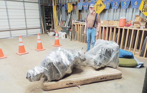 "sean mcmahon Ground preparation is complete for the Rio Blanco County Veterans Memorial on the county courthouse lawn in Meeker, but actual stone and concrete construction of the base is expected to start this week so the statue of the solder, to be dubbed ""Sacrifice and Resolution"" will be dedicated after the parade July 4. Seen with the plastic-wrapped statue that will top the memorial is Joe Dungan, the veterans service officer for Rio Blanco and the Meeker VFW post."