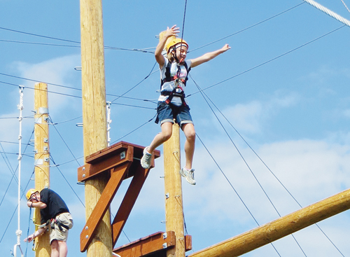 Seventh-grader Paityn Myers takes a leap of faith on CNCC's challenge course. Twenty-one Rangely middle and high school students participated in the Rangely School District's first summer challenge program, a summer school component geared toward high-achieving students. Students who completed the three-week writing- and science-based courses negotiated CNCC's Challenge Course on the program's final day.