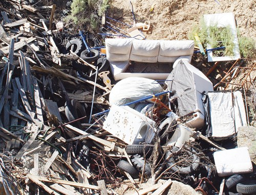 This trash-filled ravine, located a quarter-mile east of Highway 139 outside of Rangely, is a priority target area for cleanup.