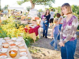 Volunteers served up fresh-baked bread along with three homemade soups made from locally harvested vegetables and meat at Thursday's Harvest Bowls Festival in Rangely. The event raised more than $7,500 for four local organizations and global relief organization Help One Now.