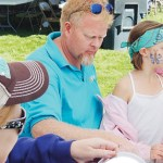 Meeker Arts and Cultural Council President Gary Zellers was one of the volunteer face painters at the Fall Festival on Saturday in downtown Meeker. All around the area, young attendees seemed to be sporting colorful art on one cheek or the other. All festivities at the festival were aimed at helping local non-profit groups raise money for their yearly projects.