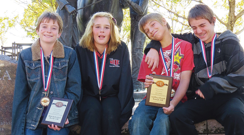 Four county youths competed and placed in many classes at the recent Northern International Livestock Exposition in Billings, Mont. From left to right are Macy Collins, Destinee Bland, Tristan Hall and Trevor Austin.