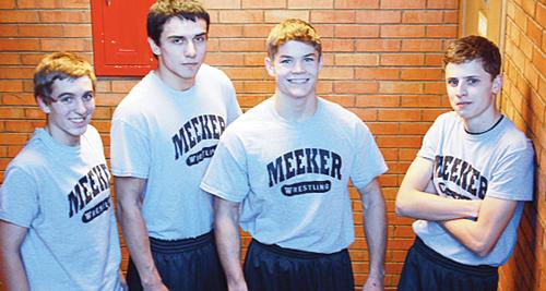 Wrestling for their final high school season are seniors Kelly Denny, Willis Begaye, J.C. Henderson and Calvin Shepherd.