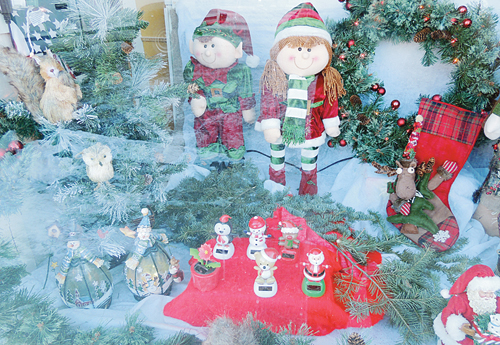 """Angie Arnold, owner of Meeker Video, was one of the businesses in Meeker that went all-out, decorating the front window for a holiday season many business owners said was """"good to average"""""""