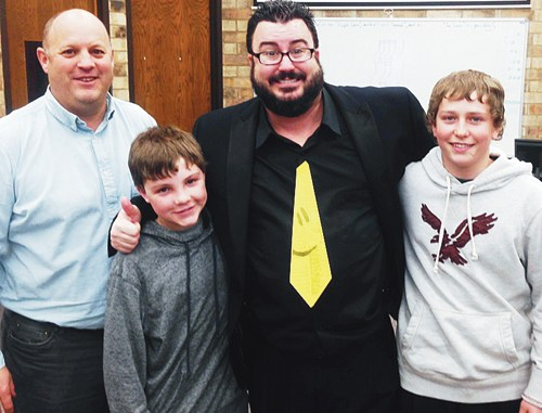 Barone Middle School Principal Jim Hanks, Jacob Pelloni, Chris Bowers and Doak Mantle.
