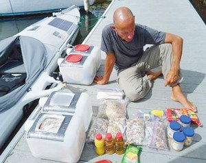 Rory Wilson loads the fruit, vegetables and nuts that will sustain him on his second solo sail to Hawaii and the surrounding waters to carry out scientific research. He had trouble with the water-making machine on the first leg of his trip but he was able to repair the system.