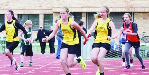 | becky hughes photo | Barone Middle School seventh-grader Krissie Luce hands the baton to her twin sister Kassie in the 400-meter relay, which they helped their team win at recent meets in  Glenwood Springs and Rangely.