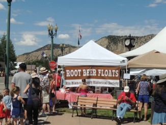 At nearly any event of any size in Meeker, it is a good bet that you will find the Rio Blanco County Historical Society in operation, offering its famous root beer floats. Above, a good-sized crowd gathered around the RBCHS booth as Friday grew warmer and more humid.