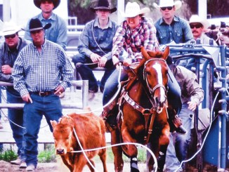 """Deena Norell, a 2014 graduate of Meeker High School, pictured roping a calf, was interviewed in a feature article about breakaway roping titled """"Whiz Kids"""" in Spin to Win Rodeo magazine and competed in the National High School Rodeo Finals rodeo  last week in Rock Springs, Wyo. Norell was quoted as saying her dad, Dee (pictured standing in black cowboy hat) is her main influence and she likes roping at home because her """"Dad's always here, he's always helping me and he's always making it fun but serious at the same time."""""""