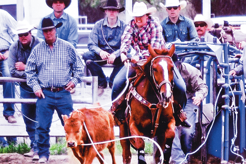 "Deena Norell, a 2014 graduate of Meeker High School, pictured roping a calf, was interviewed in a feature article about breakaway roping titled ""Whiz Kids"" in Spin to Win Rodeo magazine and competed in the National High School Rodeo Finals rodeo  last week in Rock Springs, Wyo. Norell was quoted as saying her dad, Dee (pictured standing in black cowboy hat) is her main influence and she likes roping at home because her ""Dad's always here, he's always helping me and he's always making it fun but serious at the same time."""