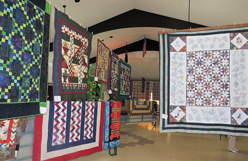 Meeker's P.E.O. Chapter BA held its annual Quilt Show on Friday and Saturday at the Fairfield Center in Meeker, and there were more than 130 quilts on hand, embellished by some fine antiques. The quilt show's Viewers' Choice went to a quilt by Lee Light of Meeker, hanging above right, and a drawing was held for a quilt to give away, and that quilt was won by Bea Blanke of Meeker.