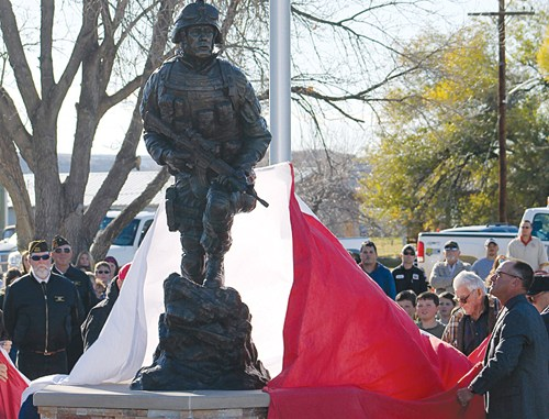 """Veterans from World War II and the Korean War unveiled John Kobald's """"Sacrifice and Resolution"""" memorial for all Rio Blanco County veterans on Tuesday afternoon in Rangely."""