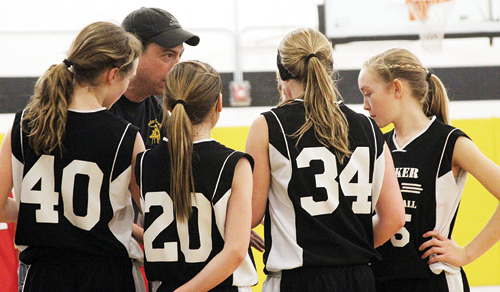 Barone Middle School seventh-grade girls' coach Tom Knowles talks with his team during a recent game. The young lady Cowboys will host the annual league tournament at the high school featuring both A- and B-team brackets, starting at 9 a.m. Saturday. Both of the A-teams are the No. 1 seeds and both will play at noon, the eighth grade against Steamboat Springs and the seventh against Rangely. Both B-teams will play at 9 a.m. Rangely's eighth-grade B-team will play Craig at 11 a.m.