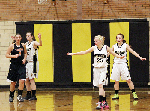 The Meeker High School girls have been using a smothering defense to create turnovers, which they quickly turn into points and wins. Meeker won at Hayden in a must-win pigtail game Tuesday and Meeker will play another must-win game tonight in Kremmling. Pictured Cowboys are Jamie McLaughlin (10), Reese Pertile, Megan Parker (25) and Sydney Hughes.