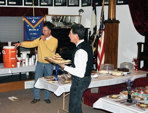 """On Sunday, the masonic brothers of Rio Blanco Lodge No. 80, AF&AM, held their annual celebration of George Washington's birthday with food, refreshment and a dessert auction. The proceeds of the auction go toward scholarships for local high school graduates to attend in-state schools. George Washington was initiated into Freemasonry in October 1752, at the age of 20 and by August of the following year was raised to Master Mason. Although there were many masons during our nation's founding years, George Washington is held by many as one of the finest examples of duty to God, our nation, our neighbors and ourselves. This year marks the 125th anniversary of the charter for Meeker's Rio Blanco Lodge No. 80 and members look forward to a new year of brotherly love, truth and charity. Left, friends and Masons celebrate George Washington's birthday as auctioneer Paul """"Buckshot"""" Sheridan and Danny DeWitt help the Masons support local scholarships."""