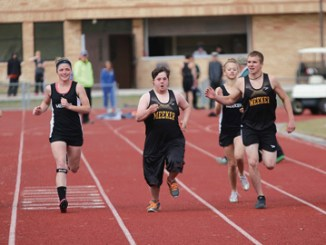 Meeker High School senior, 2014 Homecoming King and Special Olympian Marcus Archuleta, center, runs the 100-yard dash against his teammates in preparation for the Special Olympics 100-meter dash, which will be run at the 2015 Colorado State Track and Field Championships.