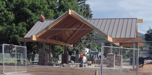 The new gazebo, located at the intersection of Fifth and Main streets in Meeker, is seen here near completion. The 1,500-square-foot facility is expected to be completed and the fence removed around the gazebo by start of Range Call activites, Commissioner Shawn Bolton said on Friday. There will be electrical hookups nearby to start and that may be replaced later with electrical boxes on each of the four corners.