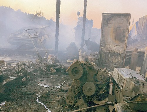 Thursday afternoon's fire caused heavy damage to Grant Rozier's property, where four outbuildings/sheds were burned, including 12 vehicles and machinery inside the buildings.
