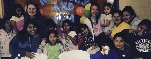Aubrey Walsh (third from the left) enjoys a surprise birthday party thrown for her by the children she worked with at the New Life Children's Home in Cieneguilla, Peru. The party was on the last day of Walsh's mission trip, which ran July 8 through Aug. 15.