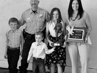 Meeker's Bailey Franklin was recently named Wildlife Officer of the Year by Colorado Parks and Wildlife. From left to right are son Monty Franklin, Bailey Franklin, son Miles, daughter Hadley and wife Ann Franklin.