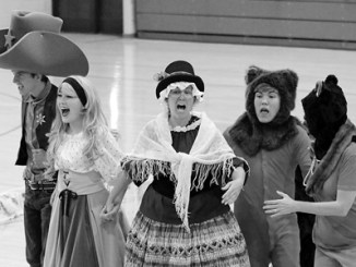 """The Yampa Valley Opera Troupe from Steamboat Springs came to Parkview Elementary School in Rangely on Sept. 24 to perform for the entire school. The six-person (plus one) troupe performed an abbreviated and contemporary wild West operatic version of """"Goldilocks and the Three Bears."""" The traveling troupe consists of high school students from Steamboat Springs and Craig as well as a few adults who produce, direct and perform in the opera.  The """"plus one"""" cast member was Caleb Wiley, a Parkview second grader, recruited at the last minute by the director to play Baby Bear. Parkview students, faculty and a few parents in attendance enjoyed the opera immensely. They especially enjoyed the songs, the comedy and watching their classmate, Caleb, ham it up."""